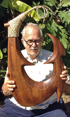Richard M. Howell with Fish Hook wood carving.