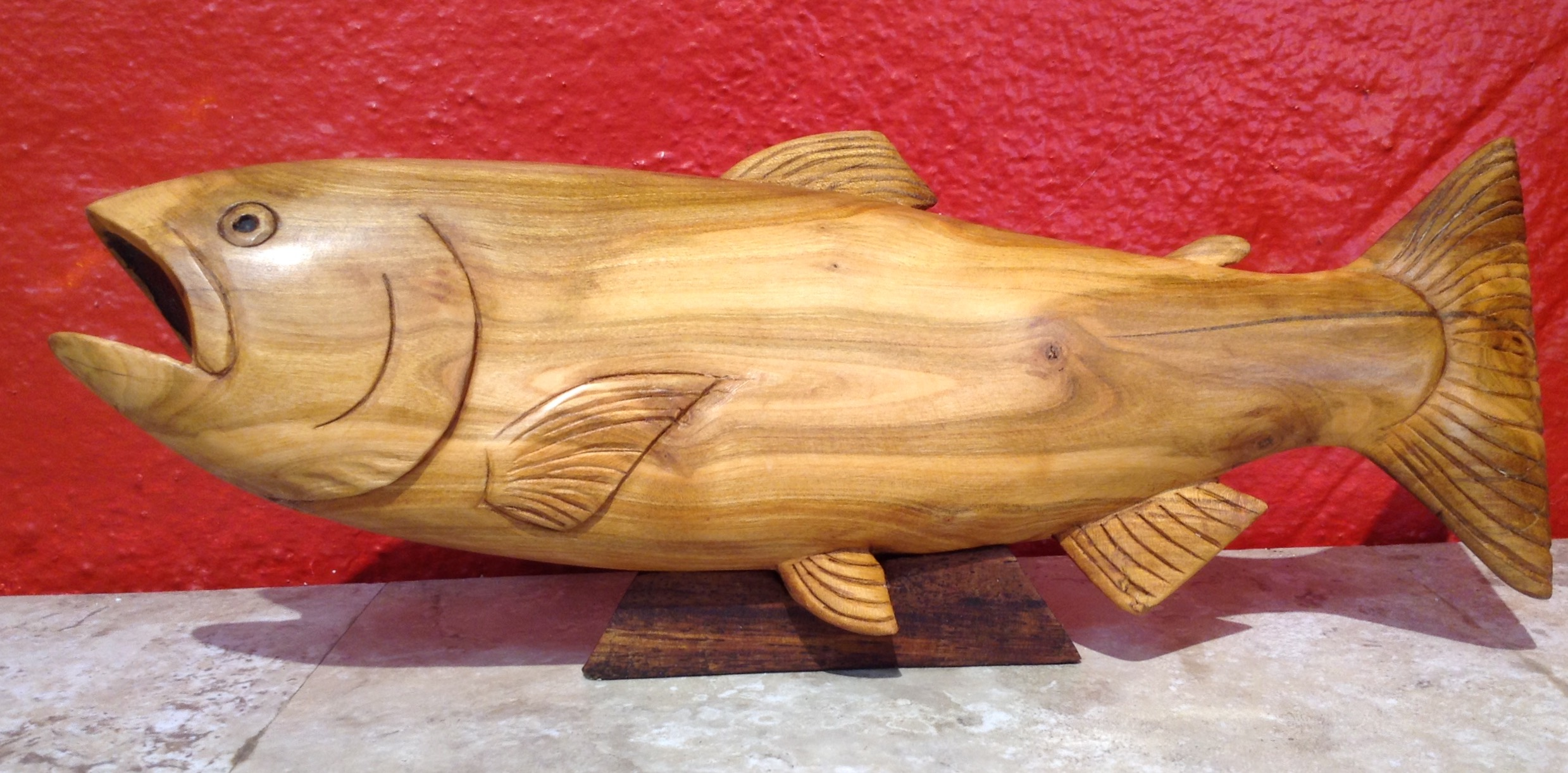 Custom carved Cherrywood salmon using wood from my client's grove.