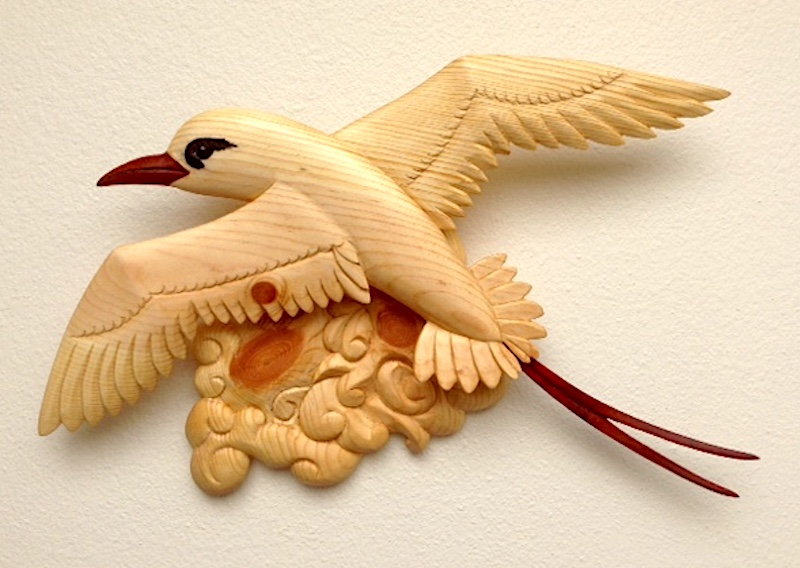 Red-tailed Tropicbird (Koa-e-ula.) finely carved pine and vermilion wood.